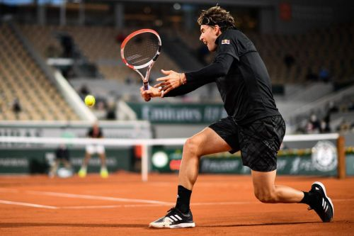 Austria's Dominic Thiem right at home in first-round win at chilly French Open