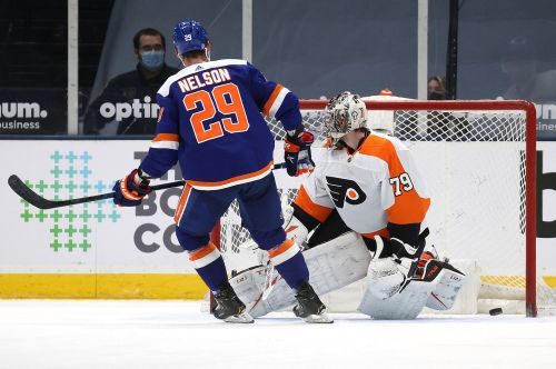 Islanders nip Flyers in shootout to move into first place