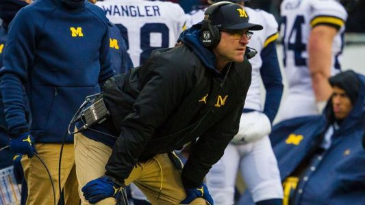 Harbaugh: Battle for Michigan's top QB 'rages on'