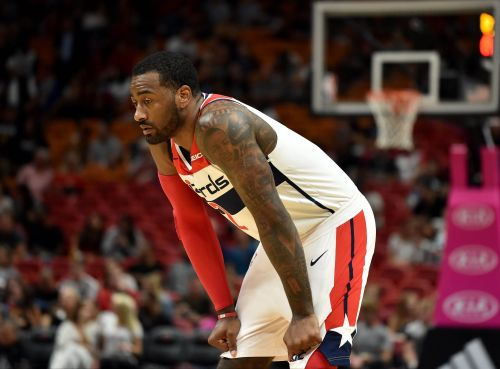 Wizards' John Wall fined for cursing at coach Scott Brooks