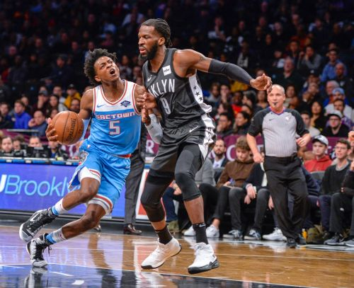 Russell has 31, Nets run past Kings for 123-94 win