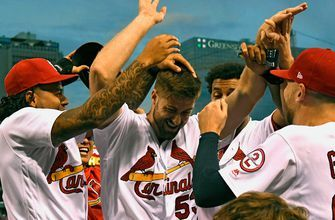 Cardinals win seventh straight game behind Gant's first MLB home run