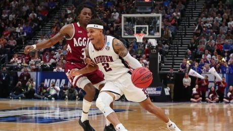 Auburn survives furious comeback by New Mexico State for close win