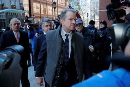 Ex-coaches among 12 to plead not guilty in U.S. college admission scandal
