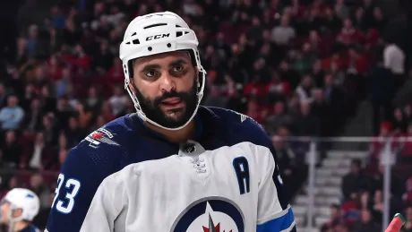 Still injured, Jets' Dustin Byfuglien to miss 3-game road trip