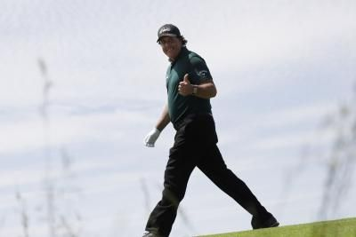 Watch: Phil Mickelson chips ball over man's head from impossible angle