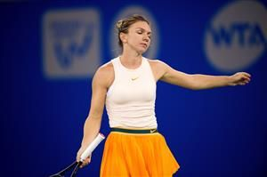 Back injury forces Simona Halep out of WTA Finals Singapore