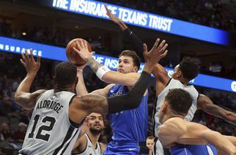 Doncic scores 42 in triple-double, Mavs top Spurs 117-110