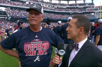 Watch the Atlanta Braves' manager get choked up after clinching the NL East division