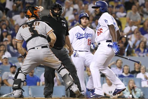 Yasiel Puig takes swing at Giants catcher as benches clear
