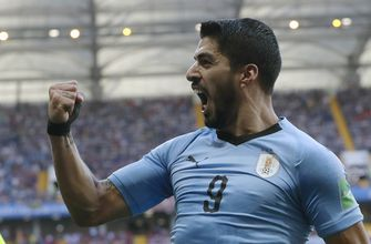 Russia faces Uruguay in World Cup with knockout round ahead