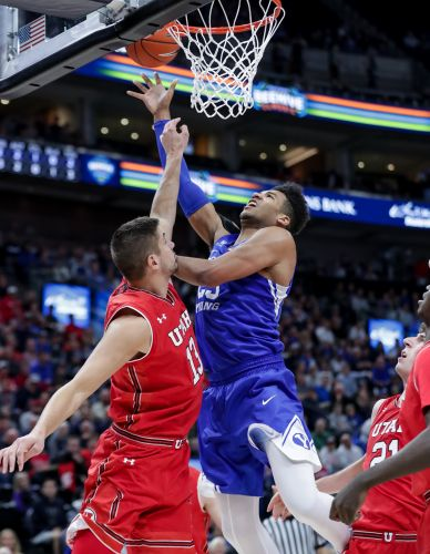 Childs shoots, dunks BYU to rivalry win over Utah, 74-59 in Salt Lake City