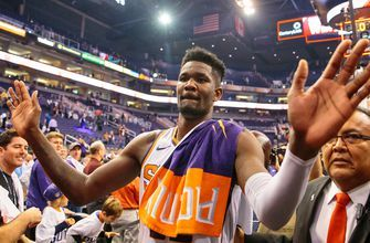 Booker's late onslaught lifts Suns past Mavs in opener