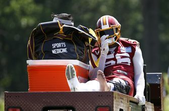 Redskins' Reuben Foster carted off field with knee injury