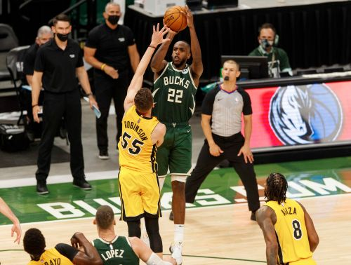 Khris Middleton's last-second shot in OT gives Bucks thrilling win over Heat as NBA playoffs begin