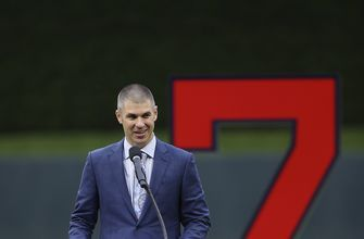 Twins hang Joe Mauer's No. 7 with other franchise greats
