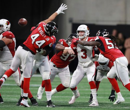 "Cardinals fall 40-14 under Falcons' ""avalanche"""