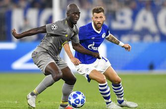 Porto earns 1-1 draw at Schalke in Champions League opener