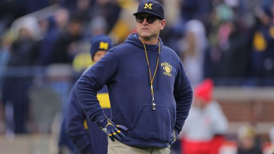 Michigan coach Jim Harbaugh marches in Ann Arbor protest