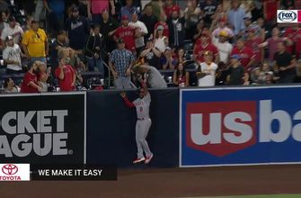 WATCH: Justin Upton leaps into the crowd and robs a potential three-run home run