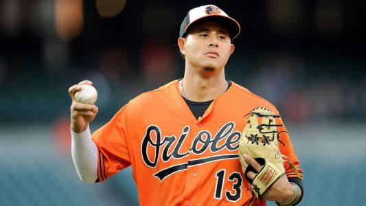 Machado's voyage from trade piece to baseball's newest $300-million man