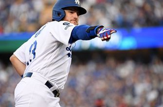 Max Muncy's grand slam gives Dodgers rain-shortened win over Nationals, 6-2