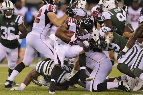 Falcons get flagged twice for violating new helmet rule