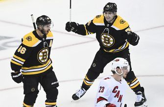 Bergeron scores in 2nd OT, Bruins beat Hurricanes in Game 1