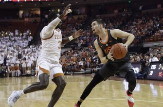 Roach and Osetkowski lead Texas over Oklahoma State 69-57