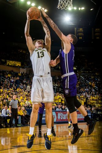 Brazdeikis leads No. 19 Michigan over Holy Cross 56-37