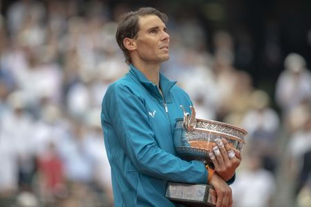 Tired Nadal withdraws from Queen's