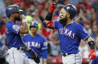 Odor hits grand slam, Rangers' bullpen beats Reds 7-1