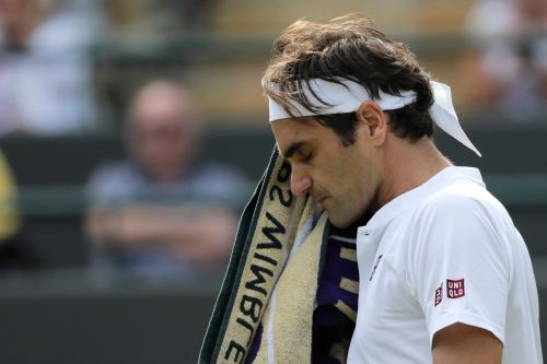 No. 1 seed Roger Federer suffers stunning upset in Wimbledon quarterfinals