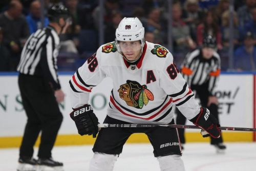 Watch: Blackhawks' Alex DeBrincat tallies hat trick in high-scoring game