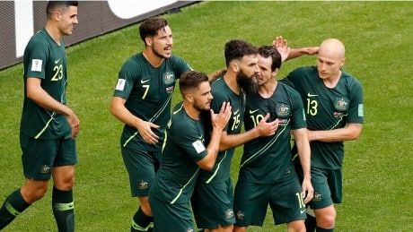 Jedinak's penalty kick helps Australia draw with Denmark in crucial Group C game