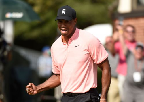 Tiger Woods shares lead in star-packed Tour Championship, FedExCup finale