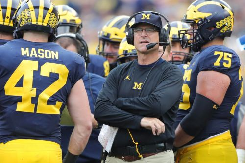 Michigan coach Jim Harbaugh says college football should be played, explains why