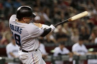 Rojas has 6 RBIs, Marlins power past D-backs 12-6
