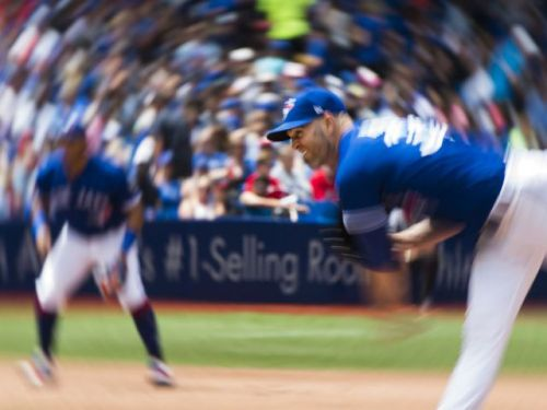 J.A. Happ nearly goes the distance as Toronto Blue Jays salvage split with surging Atlanta Braves
