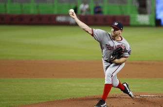 Strasburg fans 11, Nationals top Marlins 4-2