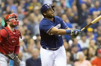 Reds held to 2 hits in 7-0 loss to Brewers