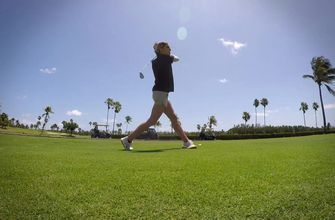 Linking up: Kelly Saco gets some golfing tips from Marlins reliever Brad Ziegler