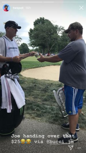 Tiger's caddie paid heckler $25 to leave tournament