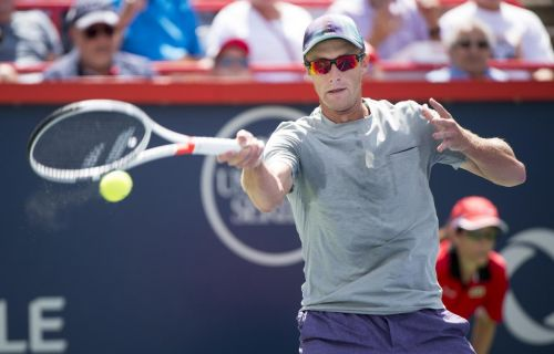 Canada's Peter Polansky wins first-round qualification match at French Open while Montreal's Francoise Abanda loses