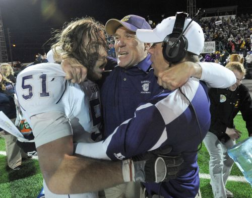 Carroll coach retires after 20 seasons, 6 national titles