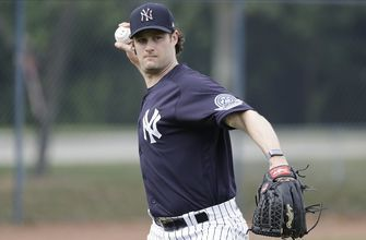 Yanks' Cole strikes out 2 in hitless inning of spring debut