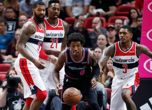 Wizards run away in the fourth, top Heat 116-110