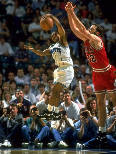 Charlotte Hornets point guard Muggsy Bogues grabs a