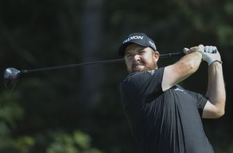 The Latest: British Open leader tees off in final round
