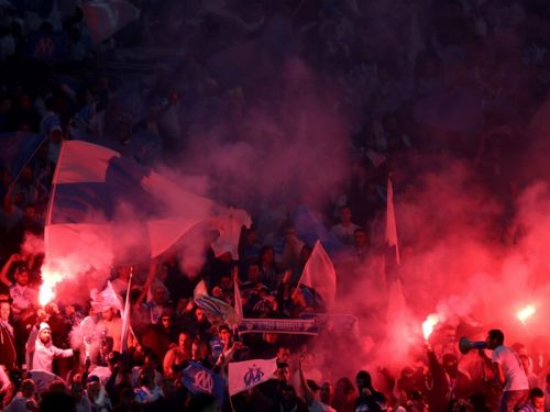 Atletico Madrid charged by UEFA over 'racist banner'